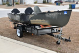 Combo of canoe plus motor plus trailer - [click here to zoom]